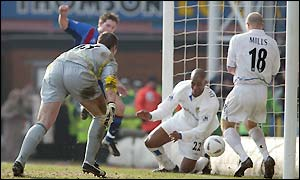 Leeds Michael Duberry and Danny Mills scramble Tommy Black's effort clear