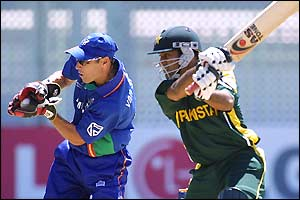 Namibian wicketkeeper Melt Van Schoor gathers the ball as Saleem Elahi plays and misses