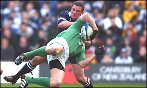 Brendan Laney makes a high tackle on Ireland's Brian O'Driscoll