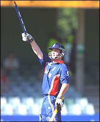 England's Ian Blackwell waves a stump towards the Barmy Army after hitting the winning runs
