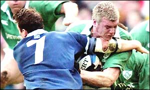 Scottish number seven Andrew Mower tries to tackle Irish flanker Victor Costello,