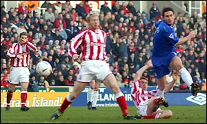 Chelsea's Frank Lampard fires in a shot under pressure from the Stoke defence