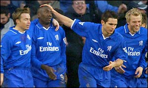 Graeme Le Saux, Jimmy Floyd Hasselbaink, Frank Lampard and Eidur Gudjohnsen celebrate taking the lead at Stoke