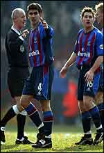 CrystalPalace's Danny Butterfield (4) and Tommy Black (16) argue with referee Dermot Gallagher after the ball appeared to go over the line