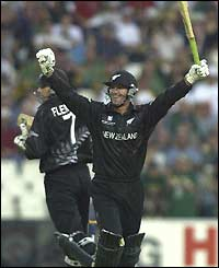 Nathan Astle celebrate reaching the revised total