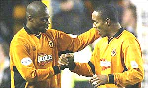 Wolves goalscorer George Ndah is congratulated by captain Paul Ince