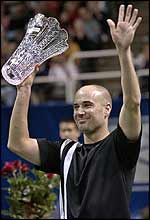 Andre Agassi holds the title aloft