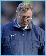 Alex Ferguson looks down after his team lost