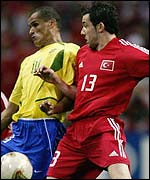 Muzzy Izzet (right) rubs shoulders with Rivaldo of Brazil in the World Cup semi-final