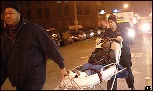 Emergency personnel carry a victim from the Epitome nightclub in Chicago early Monday morning