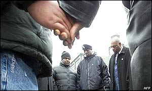 Community members pray outside the Epitome night club