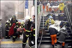 Firefighters bring out casualties from the Daegu station