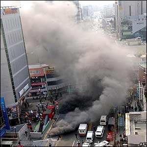 Smoke pours from a subway vent in Daegu, South Korea