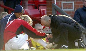 David Beckham receives treatment after picking up an injury during Man Utd's 2-0 FA Cup defeat by Arsenal on Saturday