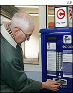 Roger Wooley from Kent pays at a self-service point in Westminster