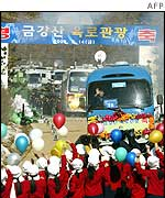 South Korean buses were welcomed as they crossed the border