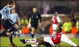 Ajax's Andy Van Der Meyde is challenged by Arsenal defender Sol Campbell