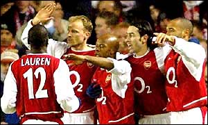 Arsenal players celebrate after Sylvain Wiltord's fourth minute goal