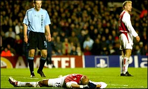 Gilberto lies on the floor in disbelief after seeing Arsenal team-mate Dennis Bergkamp miss a golden opportunity to take the lead