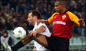 Francisco Rufete receives a high tackle from Roma's Francisco Govinho Lima