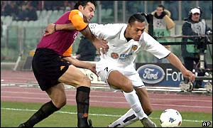 Traianos Dellas of Roma vies for possession with Valencia's John Carew