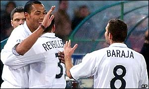 Valencia's Norwegian striker John Carew is congratulated by team-mates after scoring the winner at the Olimpico Stadium
