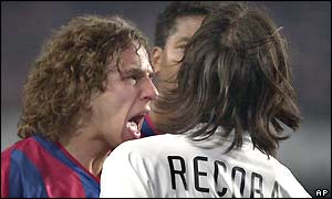 Barcelona's Carles Puyol and Inter's Alvaro Recoba exchange words before the Inter Milan player is sent off for a foul with just ten minutes of the match remaining