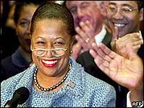Carol Moseley-Braun is cheered by supporters and family