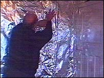 Alan Brookes puts foil up in his bedroom