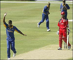 John Davison is caught by Kumar Sangakkara off the bowling of Prabath Nissanka