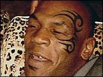 Mike Tyson shows off his new tattoo