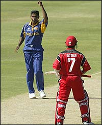 Chaminda Vaas celebrates claiming the wicket of Fazil Samad