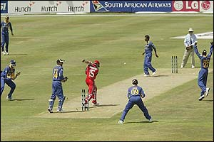 Canada's Austin Codrington is bowled by Sri Lanka's Muttiah Muralitharan