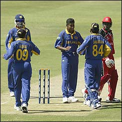 Desmond Chumney of Canada (right) looks back in anger after being caught by Kumar Sangakkara