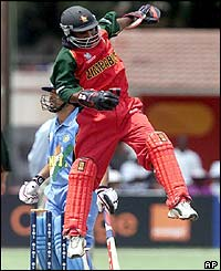 Zimbabwe's wicketkeeper Tatenda Taibu celebrates the wicket of Tendulkar