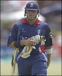 England's Alec Stewart walks back to the pavillon after being dismissed for