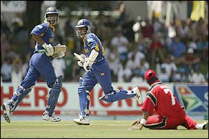 Sri Lanka's batsmen Marvan Atapattu and Kumara Sangakkara secure the nine-wicket win over Canada