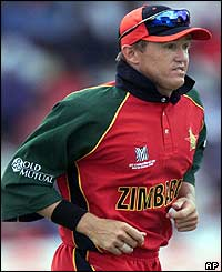 Zimbabwe's Andy Flower wears a black wristband in protest as his president Robert Mugabe