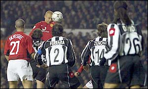Wes Brown rises to head the ball in the Juventus penalty area
