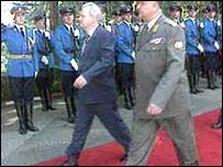 Milosevic reviewing troops
