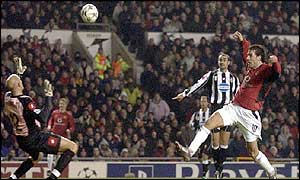 Ruud van Nistelrooy lifts the ball over the Juventus keeper to score Man Utd's second