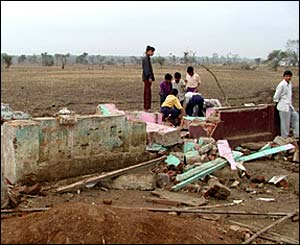 Villager in parts of Madhya Pradesh see what they can salvage from the floods that destroyed their homes