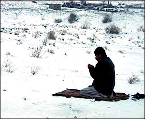 A man prays outside near to Quetta