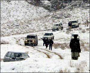 Four-wheel drive vehicles slowly make there way through the Bolan Pass near Quetta