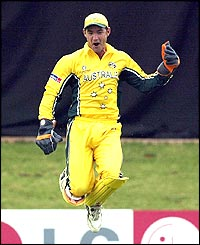 Jimmy Maher of Australia celebrates the wicket of Bas Zuiderent
