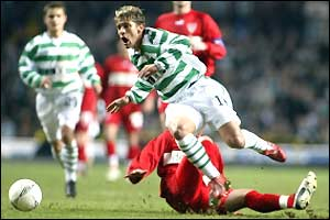 Stuttgart's Marcelo Bordon's tackle sends Celtic's Stilian Petrov flying