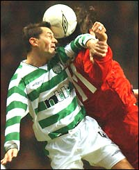 Celtic's Jackie McNamara and Ioannis Amanatidis of Stuttgart contest a high ball