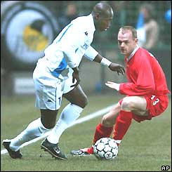 Liverpool's Danny Murphy is left wrong-footed by Auxerre's Mustapha Faye