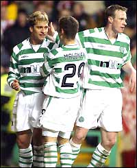 Stilian Petrov is congratulated by his team-mates after scoring Celtic's third goal