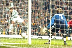 Stilian Petrov scores Celtic's third into the near corner from a tight angle